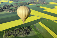 Hot air ballon flying over French countryside
